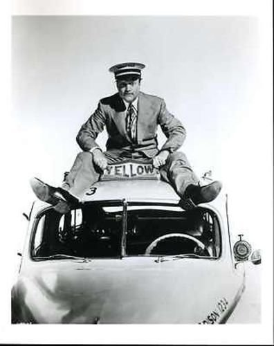 """Publicity photo of Red Skelton sitting on top of a taxi in """"The Yellow Cab Man"""""""
