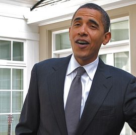 President Obama tries to cash a check